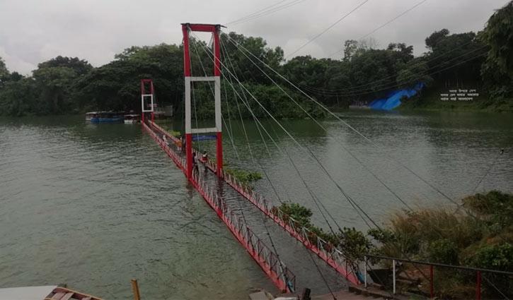 Rain submerges hanging bridge