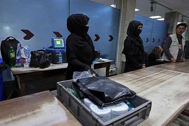 Kabul airport women return to work